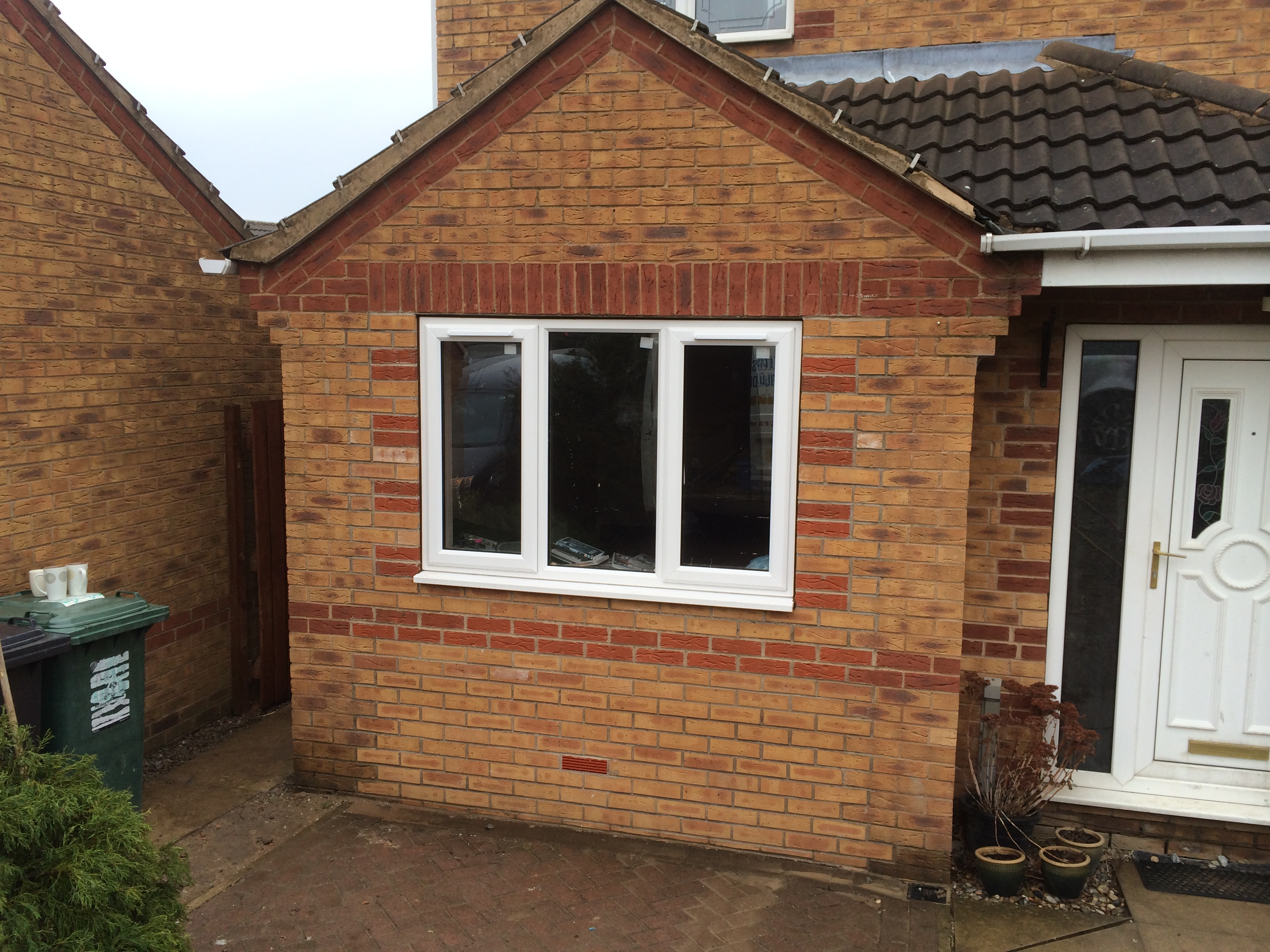 Single storey rear extension and conversion of garage into for Extension garage